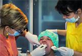 "<b>Servicii stomatologice reduse si gratuite</b> oferite de <a href=""http://www.velvetdental.ro/index.php"" target=""_blank"" rel=""nofollow"">Clinica Stomatologica Velvet Dental<br /> </a>"