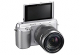 1 x un aparat foto Sony Nex F3