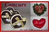 1 x un aranjament floral in forma de inima, 1 x un set de 3 cutii in forma de inima, 1 x o pernuta in forma de inima