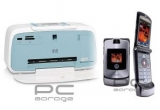 o imprimanta HP Photosmart A532 Compact Photo Printer, un telefon mobil Motorola Razr V3i, un MP3 player Philips SA2115 1GB